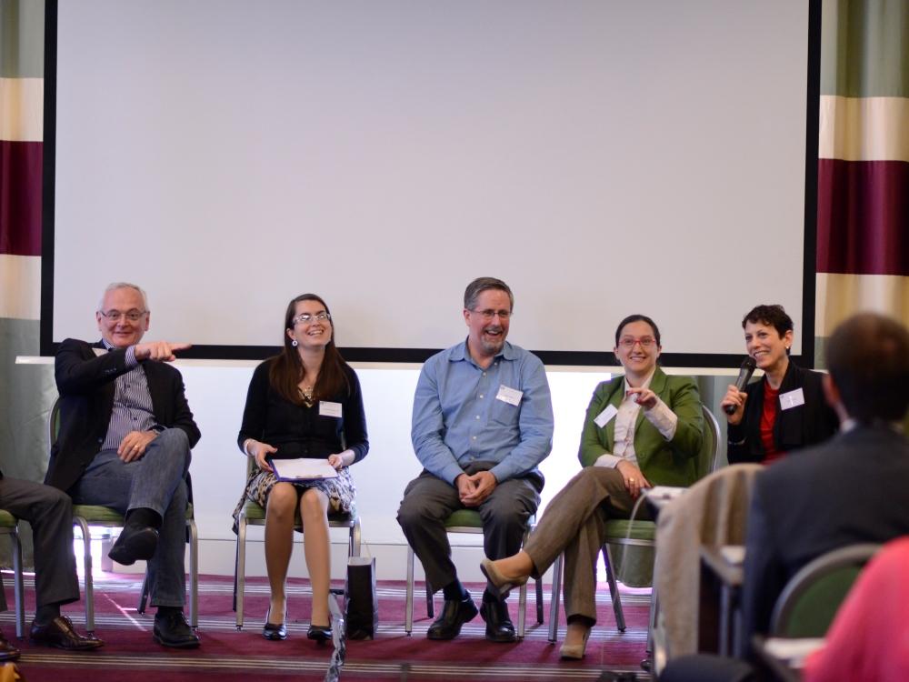 Five conference participants talking