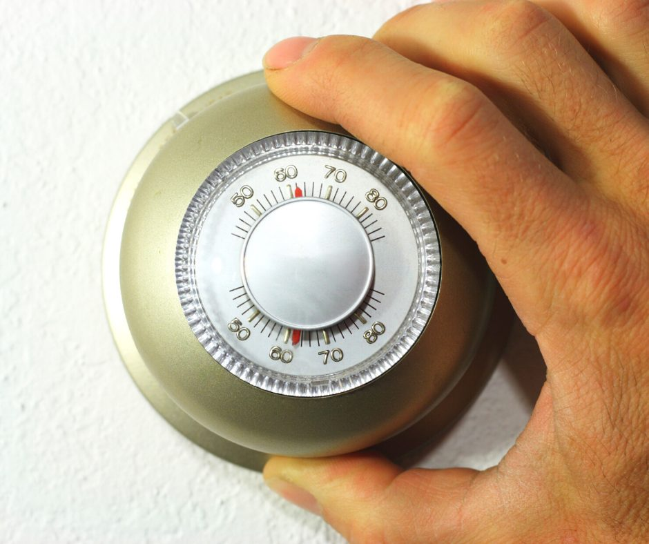 A wall thermostat being changed
