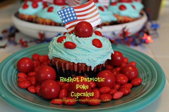 Redhot Patriotic Poke Cupcakes. Red and Blue Cupcakes. Patriotic dessert. Patriotic cupcakes. Fireball candy and Red Hots candy decorated cupcakes