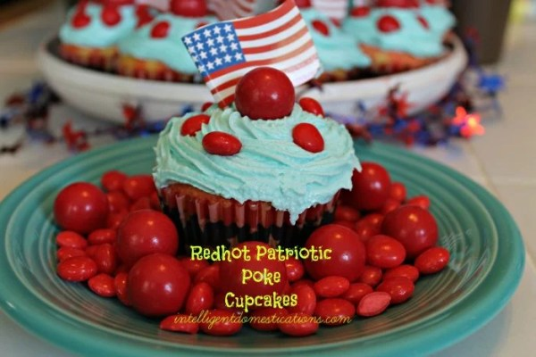 Redhot Patriotic Poke Cupcakes. Red White and Blue Cupcakes. Patriotic cupcakes. Decorate your cupcakes for the 4th of July. #redwhiteandbluedessert #patrioticdessert #cupcakes #redhots