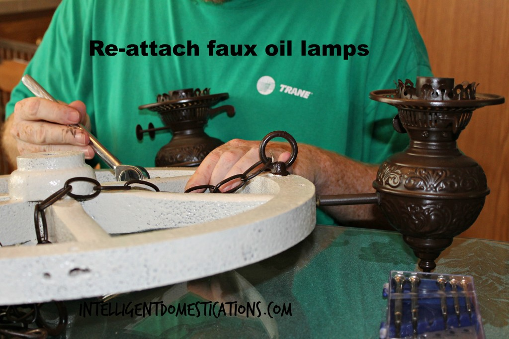 Reattaching the faux oil lamps after all paint has dried.intelligentdomestications.com