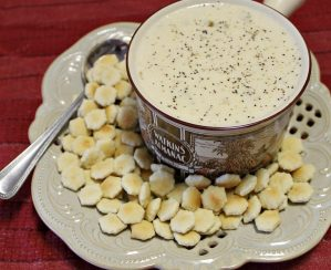 Crab stew served in a soup bowl with oyster crackers