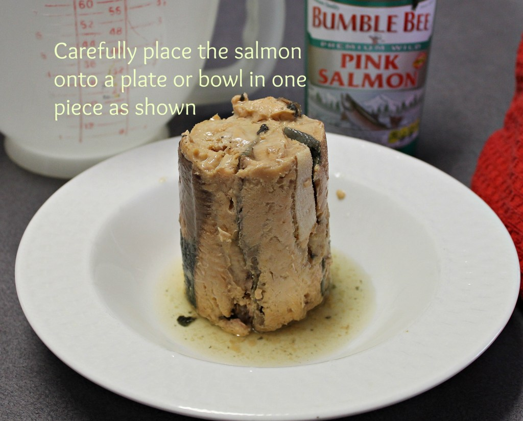 Gently place the salmon onto a plate or bowl in one piece. Then lay it over on it's side. intelligentdomestications.com