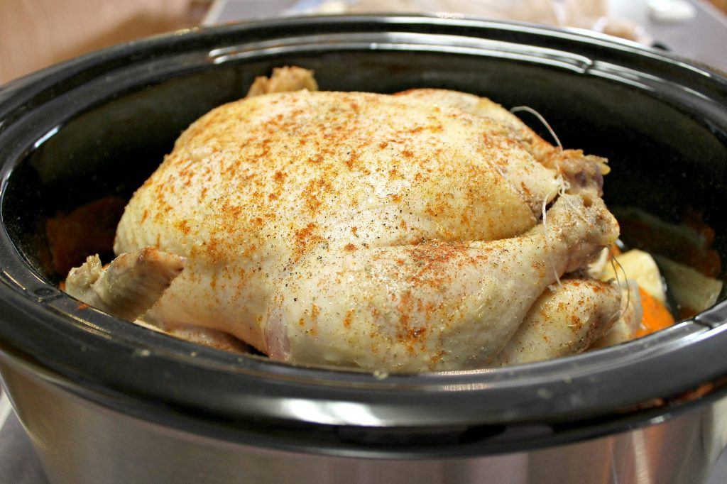 Place the chicken on top of the vegetables in the crockpot.intelligentdomestications.com