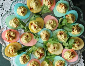 A plate full of pastel rainbow deviled eggs How to make Pastel Rainbow Deviled Eggs. Pastel Eggs for Easter. How to make pastel deviled eggs. How to make colored deviled eggs
