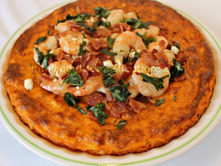 Southern Shrimp & Grits Pie is an explosion of flavors with marinara infused crock pot grits topped with a delectable combination of jumbo shrimp, basil and feta.Find the recipe at www.intelligentdomestications.com
