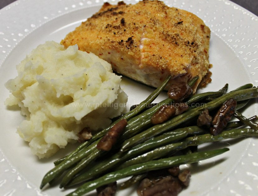 Salmon with green beans and mashed potatoes on a white dish