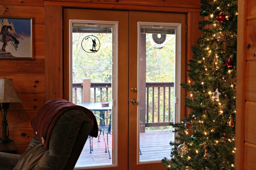 Dakota Lodge view of Christmas tree and looking out the back deck