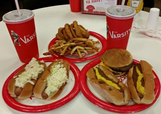 The Varsity Atlanta, Ga. Hot Dogs, Onion rings, burger and fries on a plate at The Varsity Atlanta, Ga.