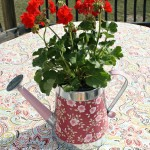 DIY DecorativeDIY Watering Can Flower Pot Centerpiece. an easy Mod Podge project.intelligentdomestications.com