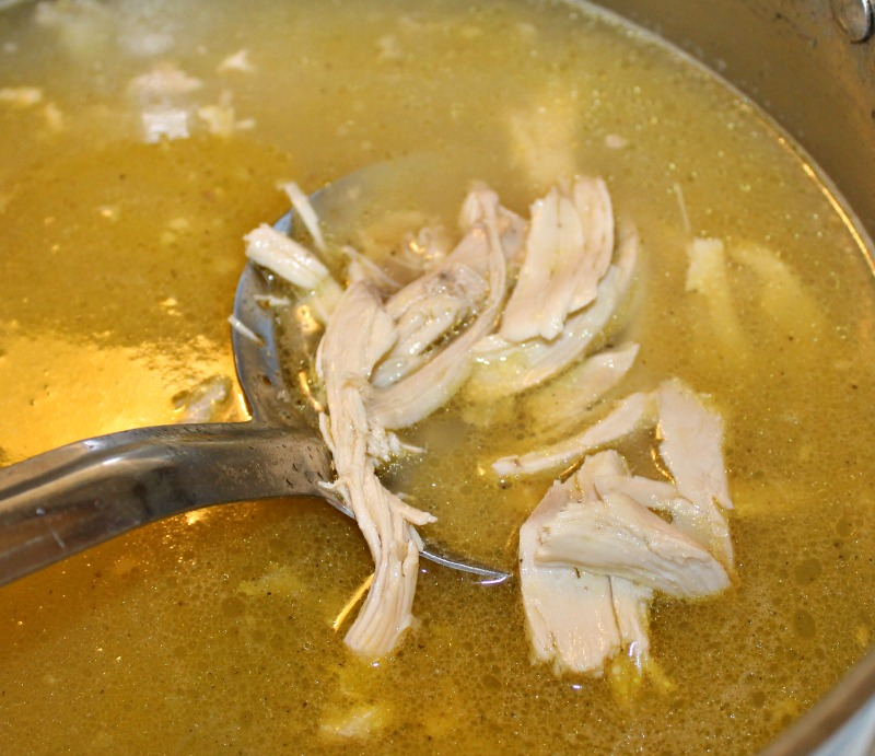 Add cooked shredded chicken to the broth