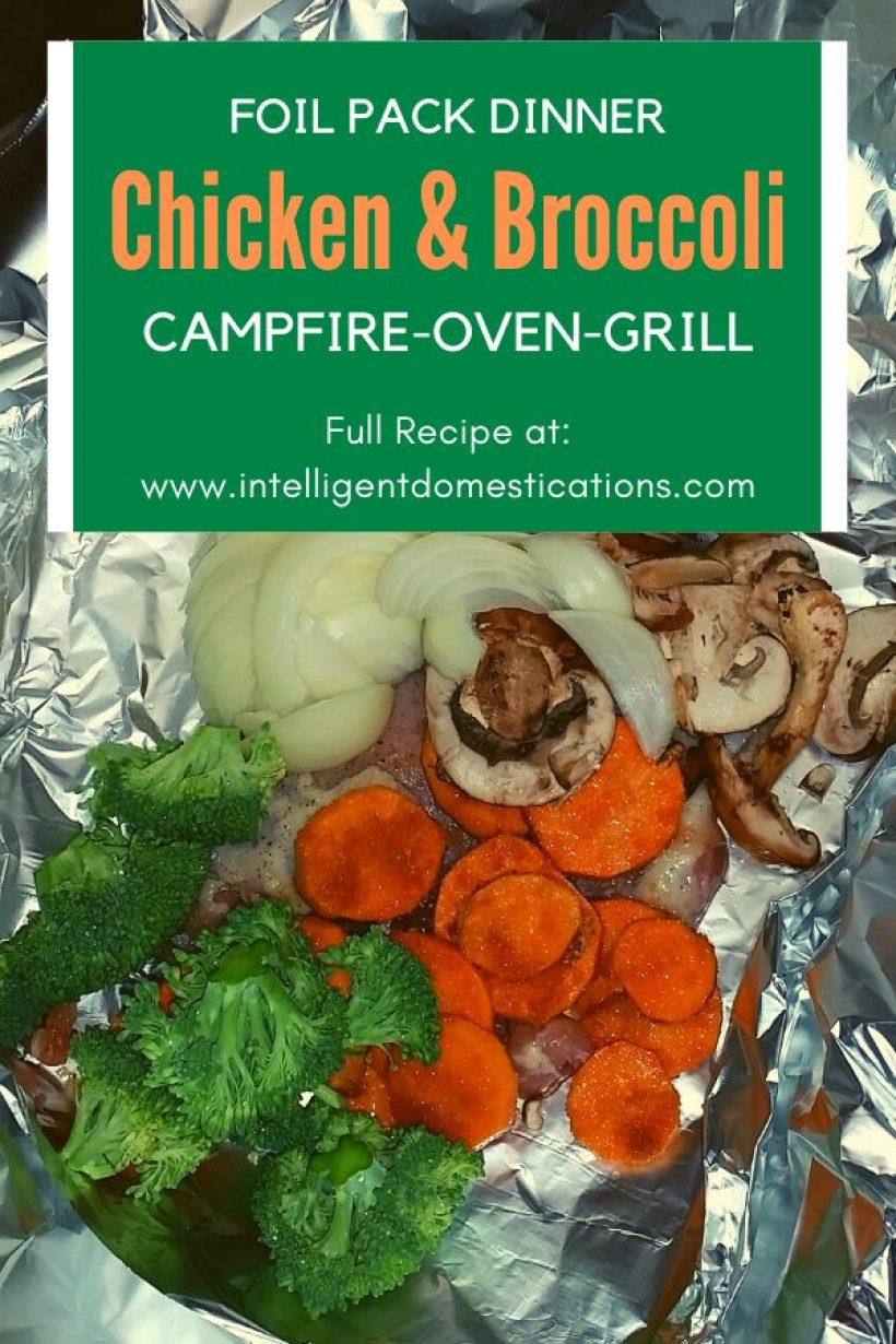 Aluminum foil laid out with vegetables on top of chicken ready to go into the oven for a Foil Pack dinner