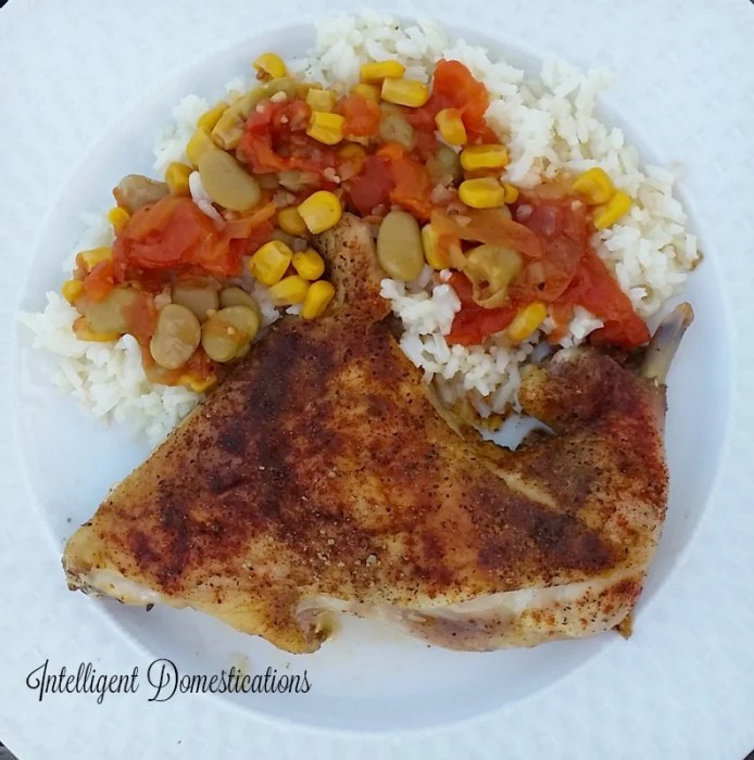Baked Chicken served with succotash on a bed or rice is a nice weeknight dinner idea