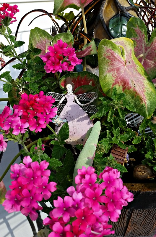 Our 2016 Fairy Garden is watched over by the Fairy Princess and her wand
