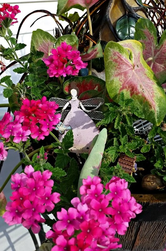 Our 2016 Fairy Garden is watched over by the Fairy Princess and her wand.My Fairy Garden Tour 2016. Fairy Garden Ideas. Flowers to use in a flower garden. #fairygarden #gnomes #fairygardenideas
