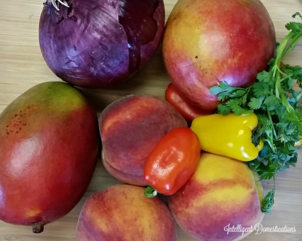 Peach Mango Salsa farm fresh ingredients. Grilled Pork Chop Menu. Grilled pork chops with grilled corn on the cob and our Honey Sweet Peach Mango Salsa. #mangosalsa #grilling #porkchops #summerfood #grilling #peachsalsa