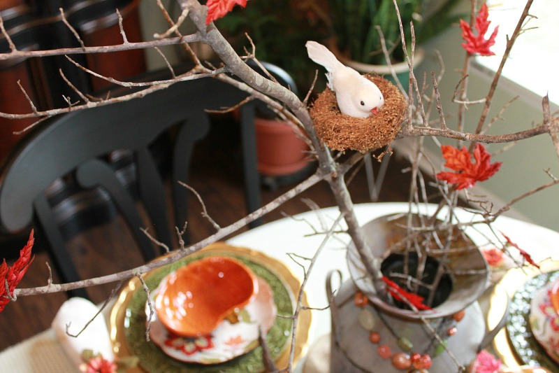 A little white dove sits in his nest as the leaves continue to fall from the tree limbs. This is such a sweet addition to our Farmhouse Style Fall Tablescape