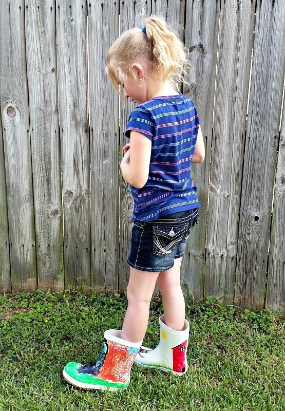 Ashley wearing her new My Design Rain Boots that she and her Papa painted together