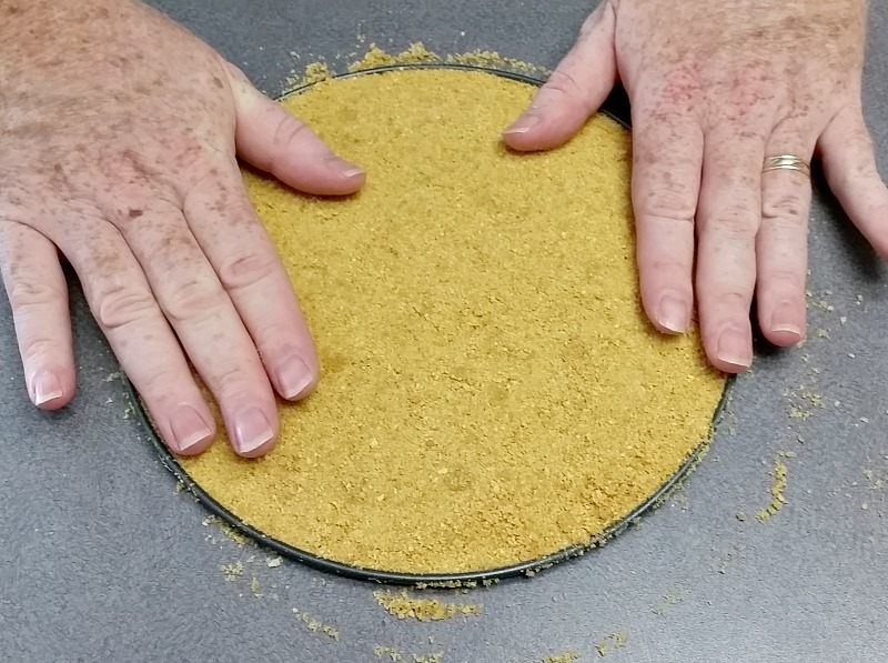 Pat the crust down good into the bottom of the springform pan