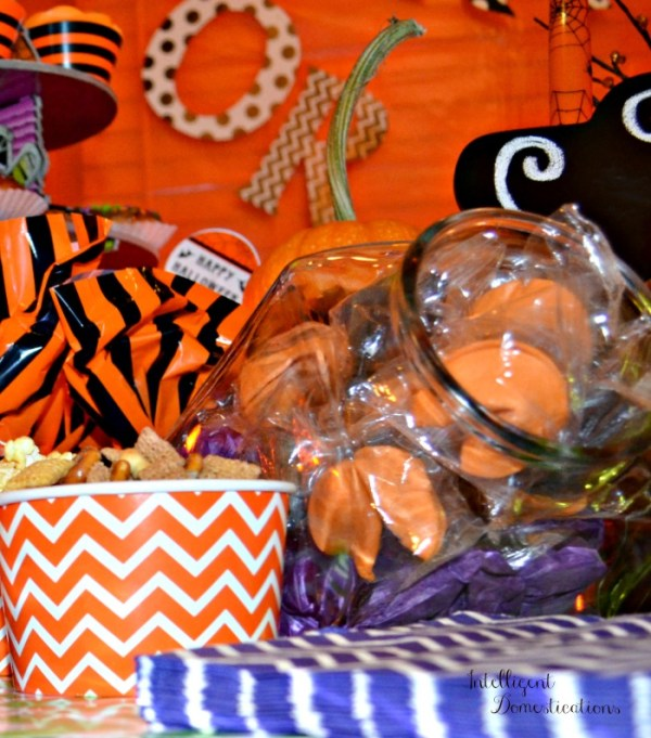 Not So Spooky Halloween party ideas. Chevron print napkins and treat cups. Orange and purple color scheme Halloween party. #halloweenparty