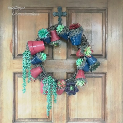 How To Make A Clay Pot Wreath featuring Patriotic colors and Succulents. The best part is that this is a Dollar Store DIY Summer Wreath for your door decor! Grab your glue gun! #wreath #diywreath #Americana