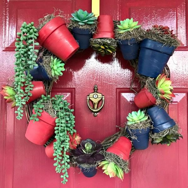 DIY Clay Flower Pot Wreath Tutorial. Make this succulent wreath using painted clay flower pots. #diywreath