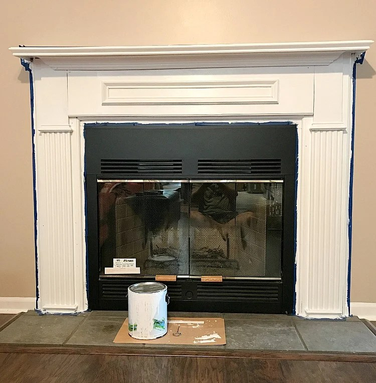 Fireplace Makeover. Painting natural wood white for a pop of color