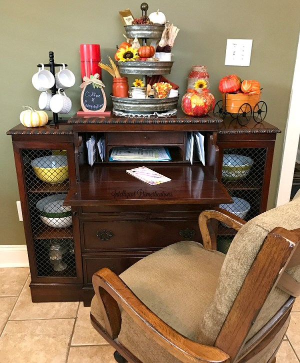 Our antique sideboard decorated for Fall showing the hidden desk