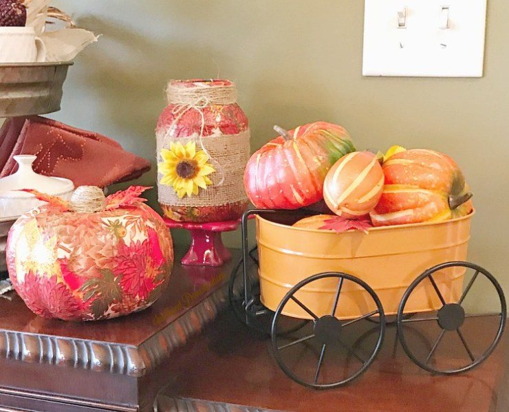 A fall decor vignette with pumpkins