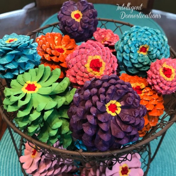 How to paint pine cones to look like zinnia flowers. Spring colors painted pine cones. Painted Pine cones. Painted Pine Cones in a Two Tier Wire Basket