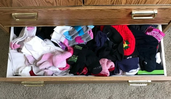Simple Sock Drawer Organization. How I organized my sock drawer without a lot of work. Uses for collapsible bins in drawer organization. Before and After Sock Drawer Organization. Before photo of sock drawer organization