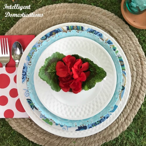 Blue and white stacked dishes. Place setting for a Fairy Garden Tablescape.