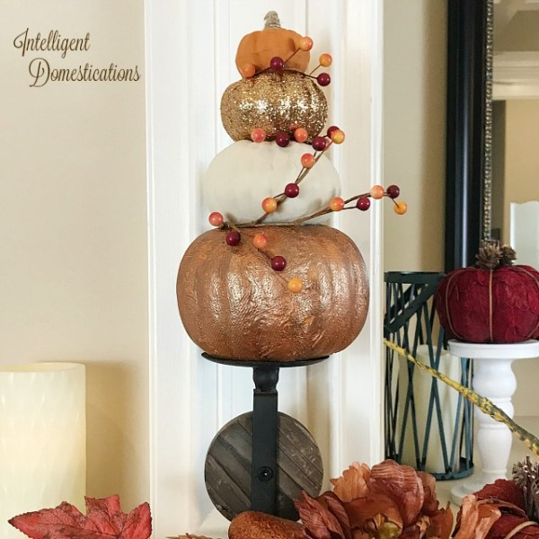 How To Make Your Own Pumpkin Topiary for mantle decor. DIY Dollar Store Pumpkin Topiary tutorial