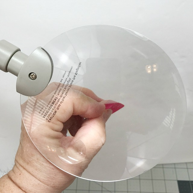 A magnify glass being used to see a small object