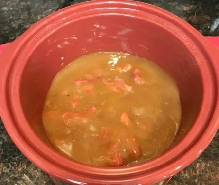 Beef Tips covered in brown gravy cooking in a Crockpot
