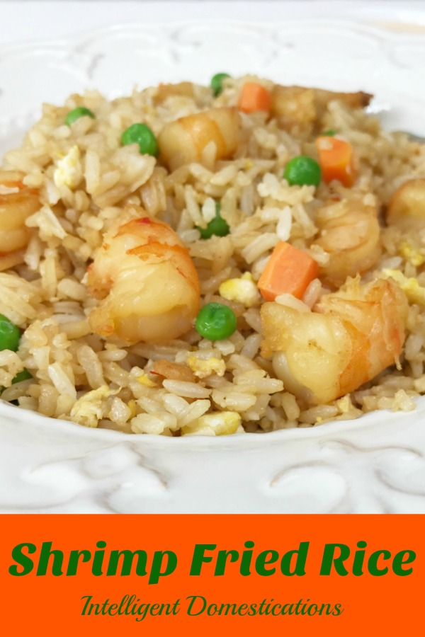 Shrimp Fried Rice is an easy recipe to make at home when you are craving some Chinese Food. Incorporate this recipe into your Weeknight Dinner Ideas because it's an easy stir fry one dish dinner. #friedrice #weeknighdinner