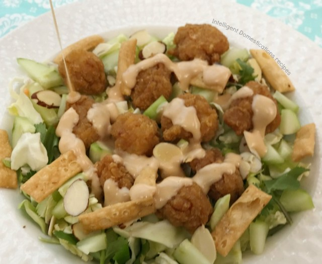 Begin with an Asian Chopped Salad Kit to create this crunchy flavorful Asian Chicken Chopped Salad with Yum Yum Sesame Dressing. #salad #asiansalad #potluckrecipe