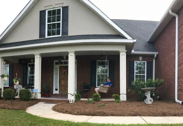 How To Create Curb Appeal. Add new bedding ground cover to your flower beds in the spring. #curbappeal
