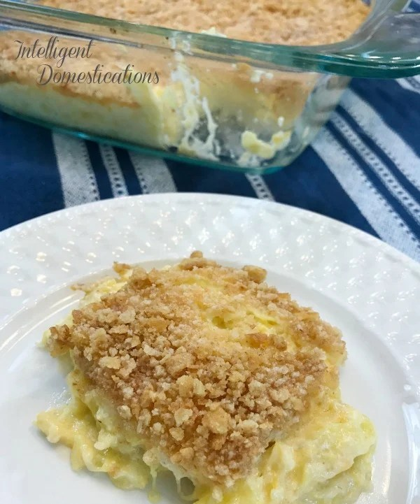 Made from scratch Squash Casserole recipe with sour cream and topped with crushed buttery crackers. #casserole #yellowsquash