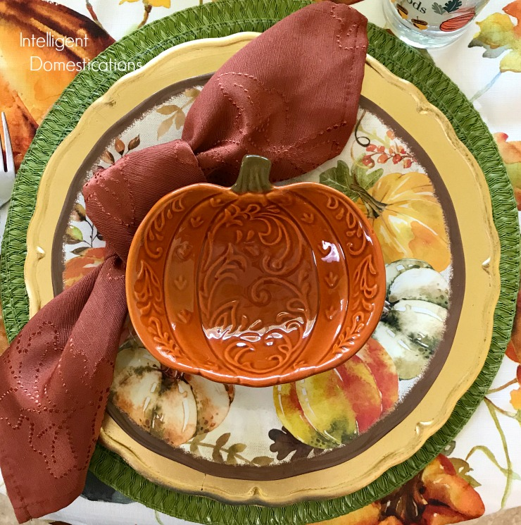 An Autumn Table place setting with a pumpkin bowl