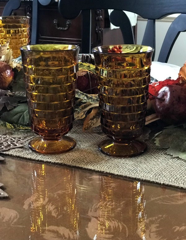 Rustic Thanksgiving Tablescape Ideas. You can create a simple rustic table for Thanksgiving using pieces you already own like we did. Our centerpiece is repurposed. Visit the blog for all the details and to see 23 more Thanksgiving Tablescape Ideas.