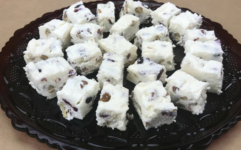 This Easy Recipe for Cranberry Pecan White Fudge is perfect for gifting or party food. Take a batch to the office party or Christmas Pot Luck.