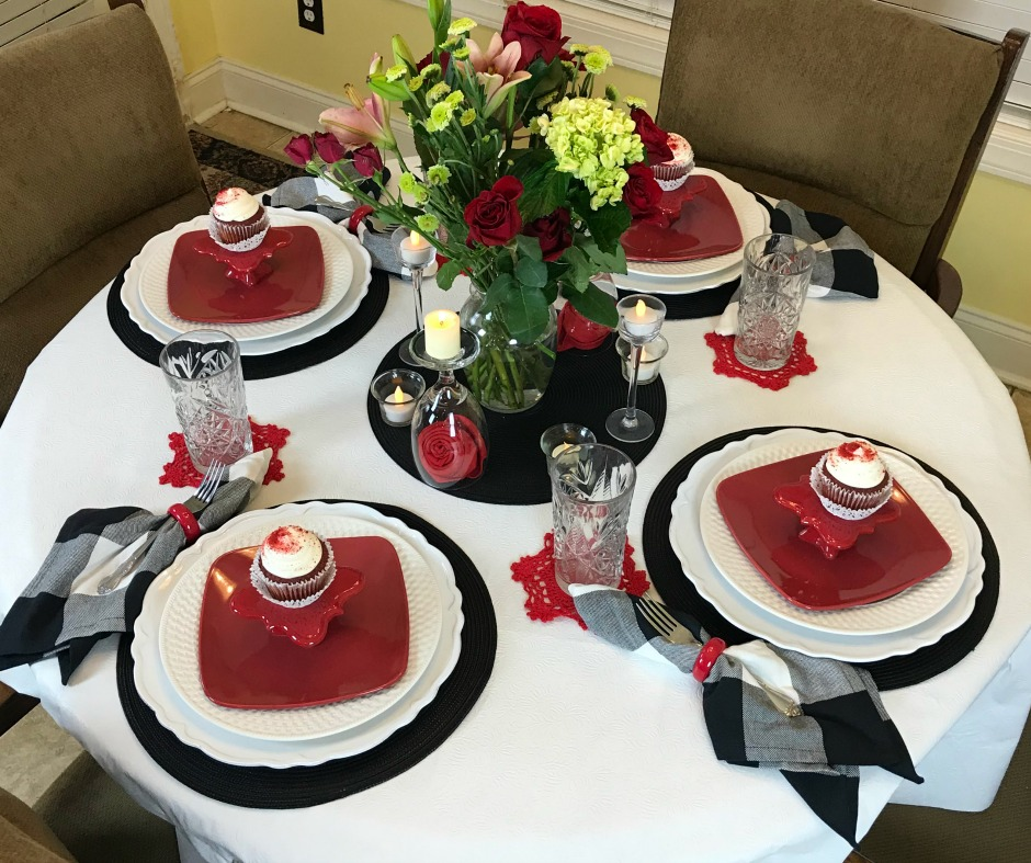 Red White and Black simple Valentine Tablescape ideas to create at home. Our Valentine table decor is suitable for a special meal at home with friends. Set the mood with colors, candles and live flowers.#intellid