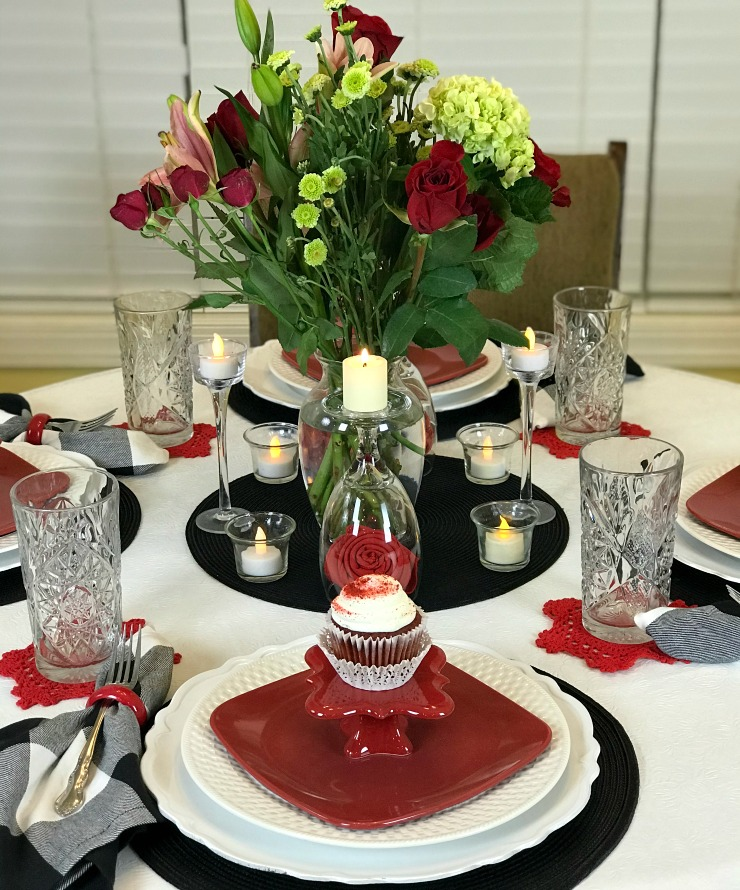 Valentines Tablescape decor ideas using red white and black colors. A Live flowers centerpiece was our only expense as we used dishes we already own and decor which transitions from one season to the next.
