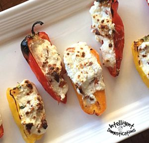 Charred cheesy bacon stuffed peppers displayed on a white dish