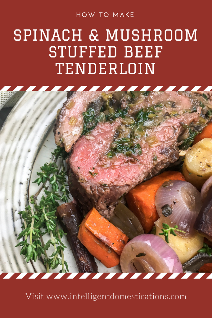 A white plate filled with stuffed beef tenderloin, carrots, onions and shallots