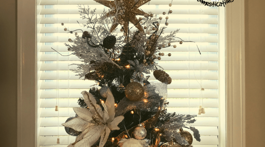 Top of a silver and gold decorated Christmas tree