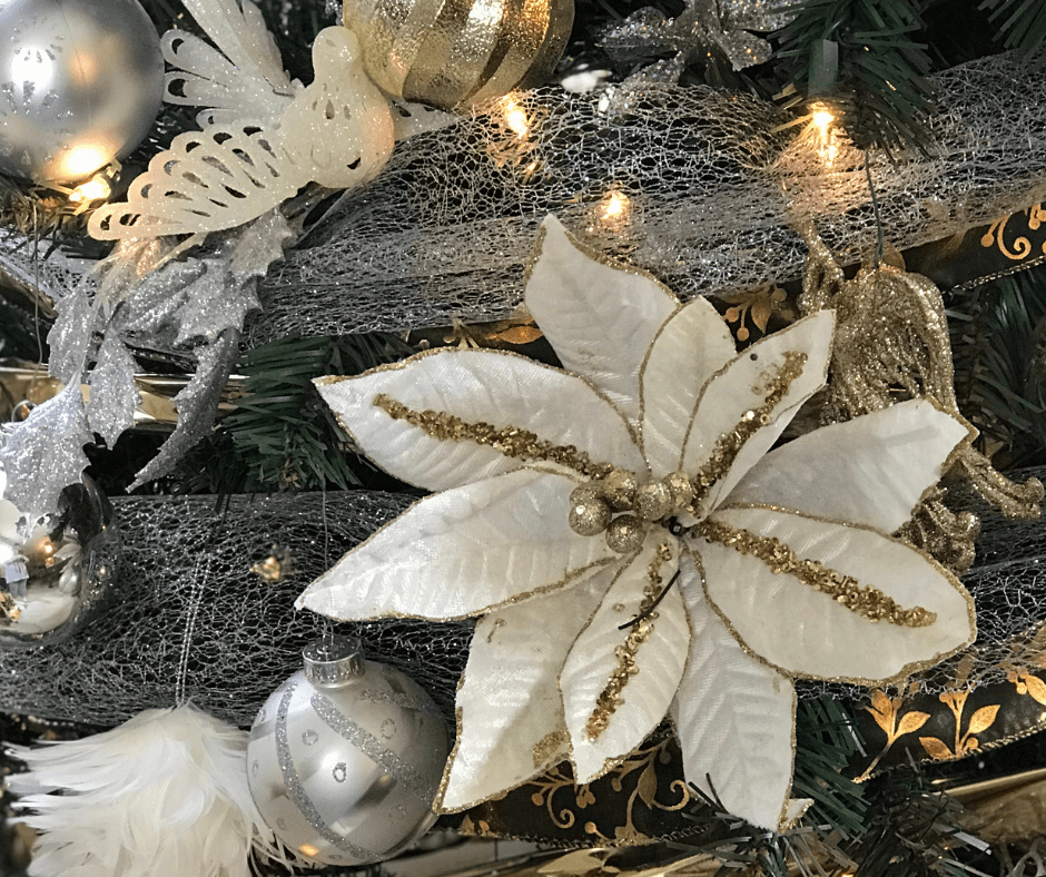 White flower on a Silver and Gold decorated Christmas tree