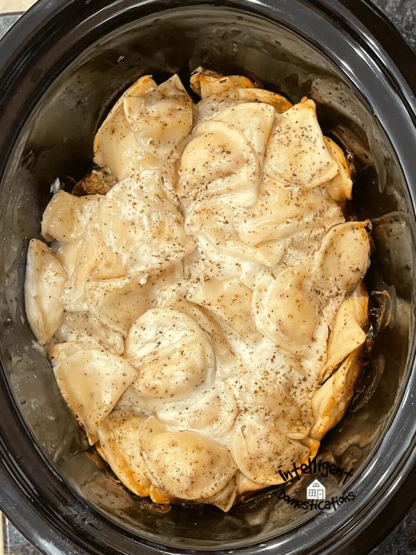 Pierogies in the Crockpot on top of meatballs