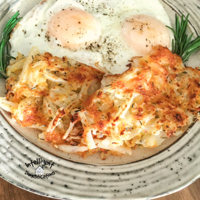 Homemade Crispy Hash Browns served on a white plate with over easy eggs